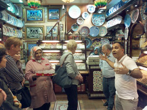 The owner of a spice shop in the Grand Bazaar draws a crowd.